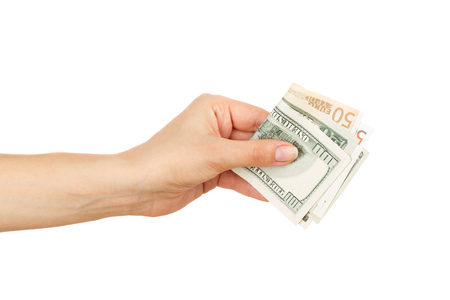 One hundred dollars and Fifty euro in the womans hand, light background