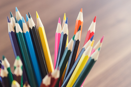 stylus: Set of colored pencils in the glass on the wooden background