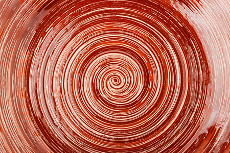 Dark brown gloss background with spiral pattern Stock Photo