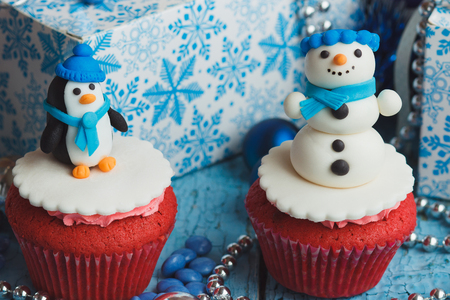 Christmas cupcakes with colored decorations made from confectionery mastic
