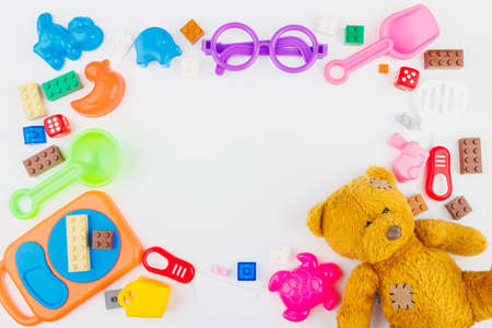 Kids toys background with colorful blocks on the white background