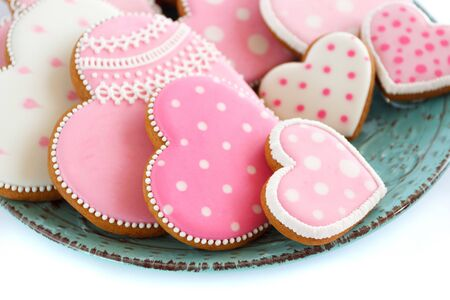 Set of pink heart shaped cookies with patterns, handmade, light background