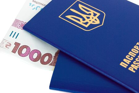 Two Ukrainian passports and one thousand hryvnias, isolated on the white
