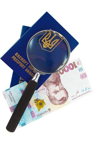 Two Ukrainian passports, loupe and one thousand hryvnias, isolated on the white