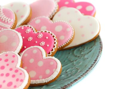 set of pink heart shaped cookies with patterns, handmade, light background Archivio Fotografico - 137766493
