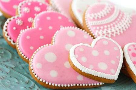 Set of pink heart shaped cookies with patterns, handmade, light background Archivio Fotografico - 137766924