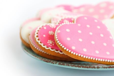 set of pink heart shaped cookies with patterns, handmade, light background Archivio Fotografico - 137766845