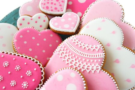 set of pink heart shaped cookies with patterns, handmade, light background Archivio Fotografico - 137766661