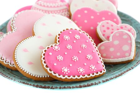 set of pink heart shaped cookies with patterns, handmade, light background Archivio Fotografico - 137766918