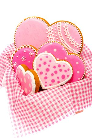 set of pink heart shaped cookies with patterns, handmade, light background Archivio Fotografico - 137766636