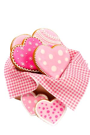 set of pink heart shaped cookies with patterns, handmade, light background Archivio Fotografico - 137767179
