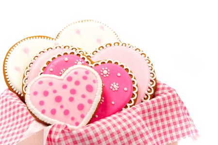 Set of pink heart shaped cookies with patterns, handmade, light background Archivio Fotografico - 137767354