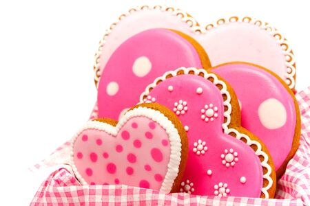 set of pink heart shaped cookies with patterns, handmade, light background Archivio Fotografico - 137774827