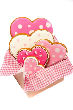 set of pink heart shaped cookies with patterns, handmade, light background Archivio Fotografico - 137774510