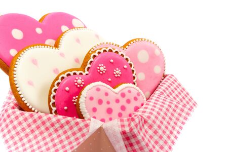Set of pink heart shaped cookies with patterns, handmade, light background Archivio Fotografico - 137774648