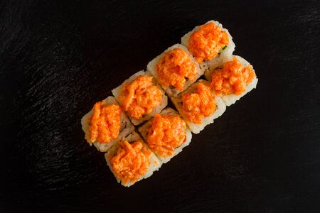 Japanese food: Set of salmon sushi and rolls with salmon and eel, top view