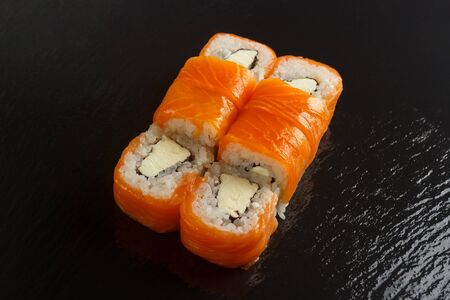 Japanese food: Set of salmon sushi and rolls with salmon and eel, top view 写真素材