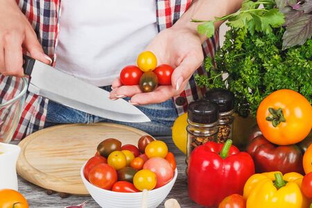 Woman cooks at the kitchen, body part, soft focus background