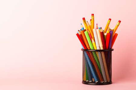 Black glass with felt-tip-pens, saturated pink background Reklamní fotografie