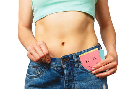 Slim beautiful woman wears jeans large size, diet and health concept