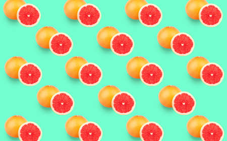 Collage from ripe grapefruits on the light green background
