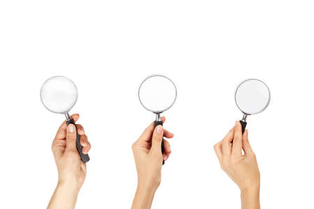 Magnifying glass in the hand, isolated on white
