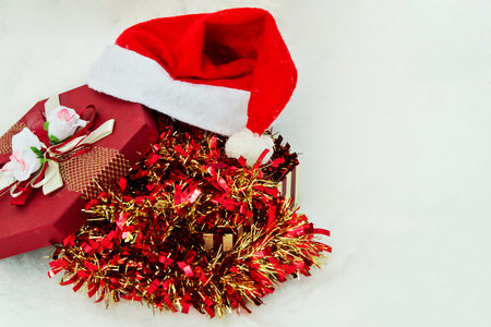 the tinsel: tinsel with gift and santa hat Stock Photo