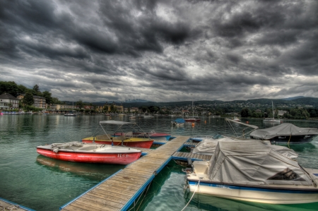 Clouds and lake with boats photo