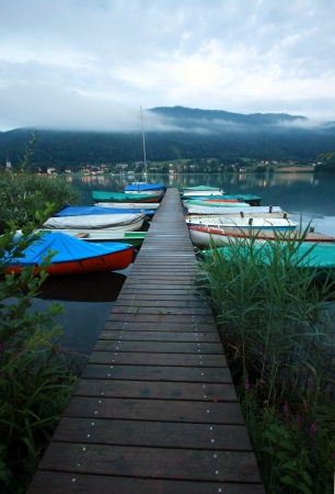 a wooden pier with boats  photo