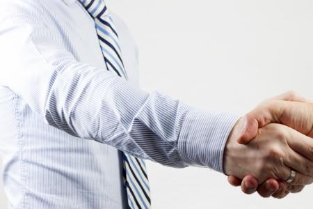 giving handshake on isolated background photo