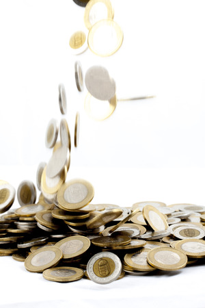 falling coins on isolated background photo
