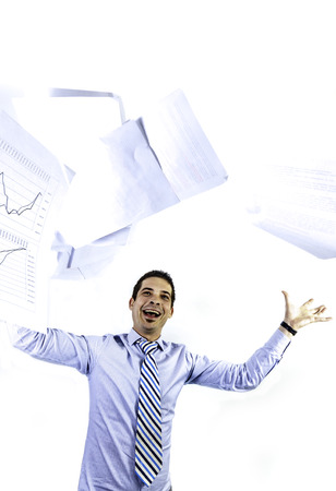 causasian: happy businessman throw up papers on isolated background