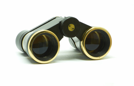 voyeur: Isolated thater black binoculars with golden ring over white Stock Photo
