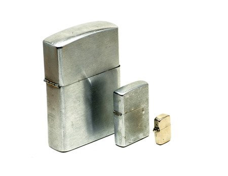 encendedores: Three different sizes of metallic lighters with cap closed