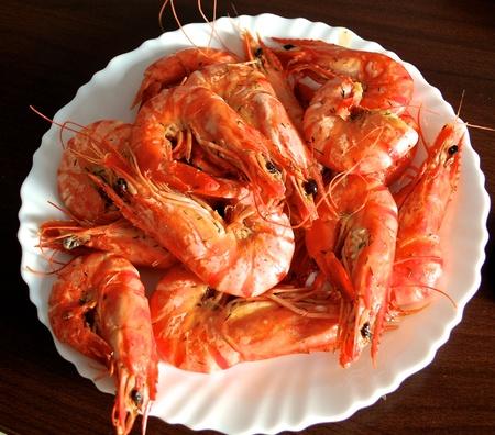 prepared shrimp: Fried shrimps on a  white plate with cilantro