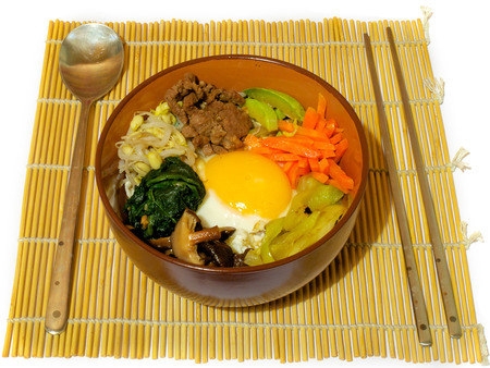 bap: Bibimpab korean dish with vegetables, beef and egg on rice