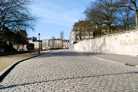 histories: Stone paving in Nantes near the castle in winter Stock Photo