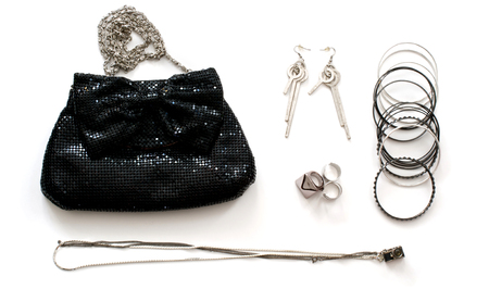 clutch bag: Isolated black clutch bag with accessories in rock style over white Stock Photo