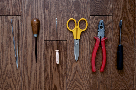 crimper: Wooden background with clear wooden pattern with tools Stock Photo