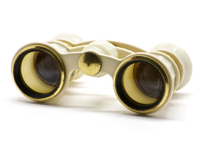 voyeur: Isolated theater white binoculars with golden ring over white