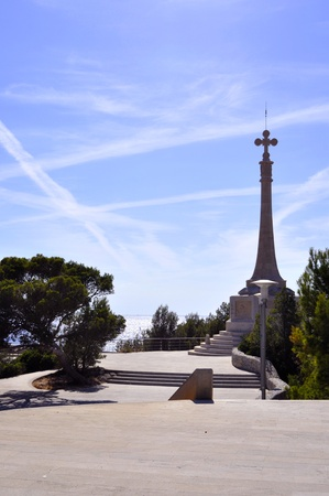 santa cross: Monument cross in Santa Ponca over blue clear sky