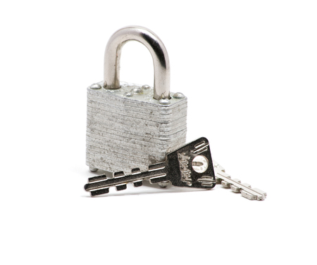 safe and sound: Isolated close up of silver lock and keys