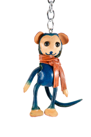 bibelot: Isolated close up of keychain blue monkey over white
