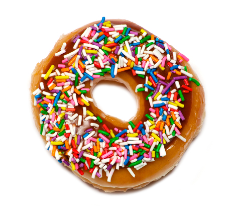 sweet and savoury: Isolated  colorful donut with topping over white