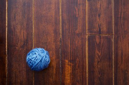 skein: Blue skein over wooden brown striped table
