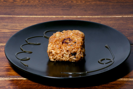 mouthwatering: Korean rice sweet treat over black plate on the table