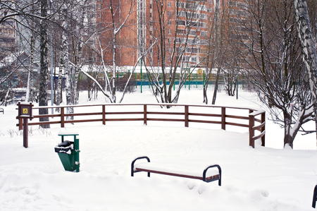 wooden railings: Wooden railings and bench with a lot of snow