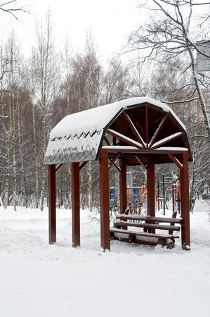 bower: Alcove covered with snow in park during heavy snowfall