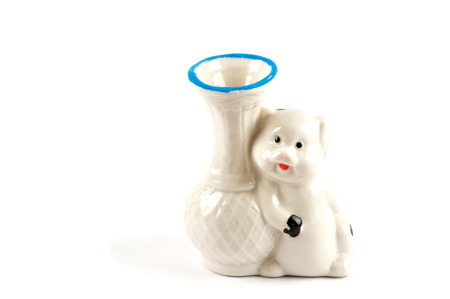 animal figurines: Isolated white vase with pig over white Stock Photo