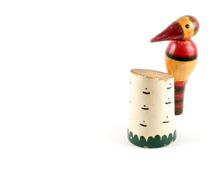 pleasure craft: Colorful small hand-made wooden figurine of woodpecker